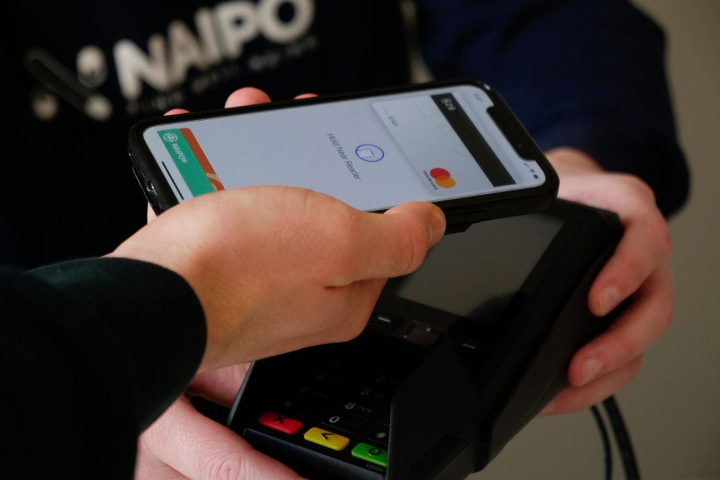 Person paying with credit card reader